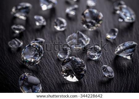 Photo of diamonds on dark metal surface - stock photo