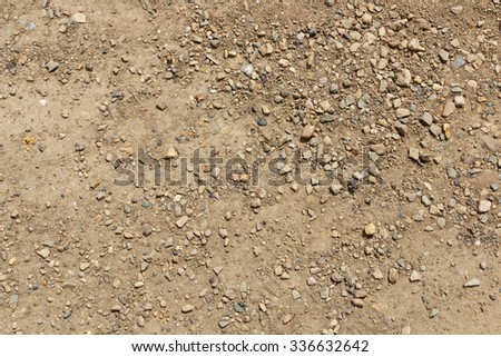 Photo of dirt and dusty road with small stones - stock photo