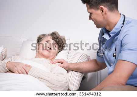 Photo of doctor and elderly woman with health afflictions - stock photo