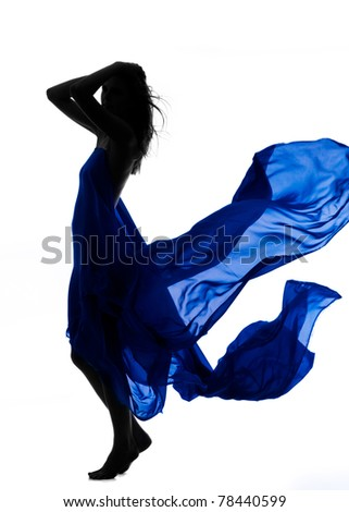 Photo of dynamic, beautiful woman wrapped in blue fabric over white background; a lot of copyspace available.
