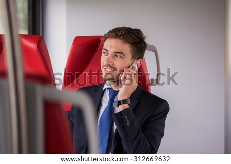 Photo of eco living businessman using train instead of car - stock photo