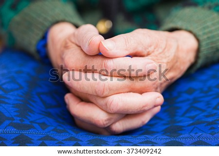 Photo of elderly woman wrinkled hands  - stock photo