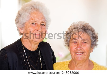 Photo of elderly women smiling to the camera - stock photo