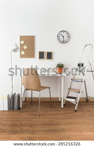 Photo of elegant study room with wooden floor