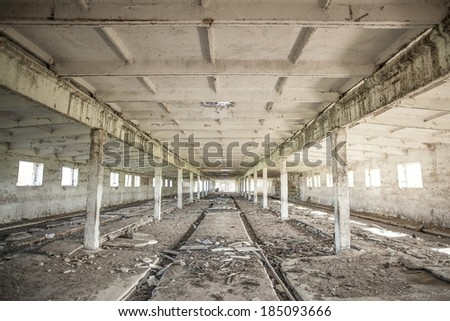 Photo of empty space concrete room interior with light in windows and dirty beam in perspective Background of industrial warehouse with old trash