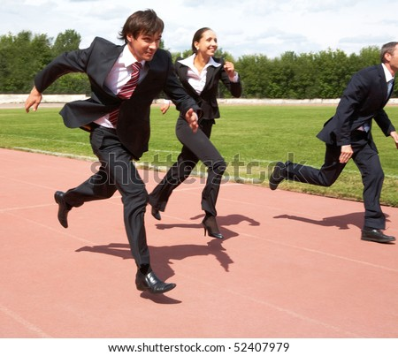 Photo of energetic business people in suits running - stock photo