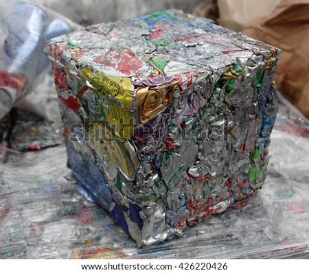 Photo of extruded aluminum waste in the form of a cube with a local focus                                 - stock photo