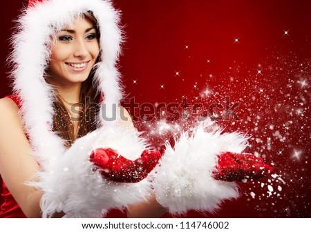 Photo of fashion Christmas girl blowing snow. - stock photo