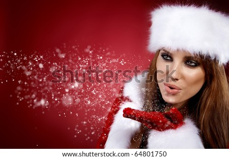 Photo of fashion Christmas girl blowing snow. - stock photo