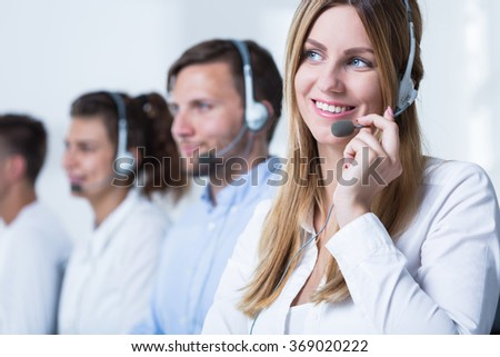 Photo of female call agent working in tele service - stock photo