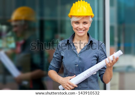 photo of female constructor with blueprints - stock photo