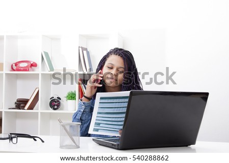 photo of female young with the phone mobile and it computer laptop in the apartment