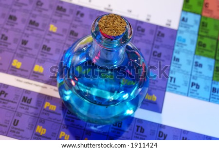 Photo of Flask on a Periodic Chart - Potion / Science - stock photo