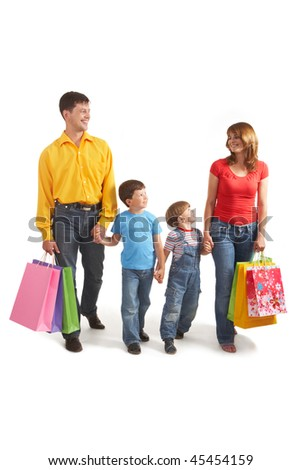 Photo of friendly parents and siblings with bags walking after shopping - stock photo