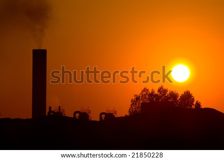 Photo of fume chimney in orange sunset