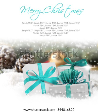 Photo of gifts with colorful ribbons, falling snow and white space
