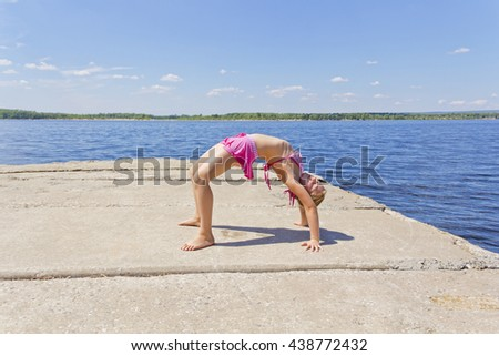 Photo of girl practices yoga in pose footbridge