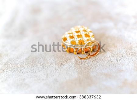 Photo of golden wedding rings before ceremony - stock photo