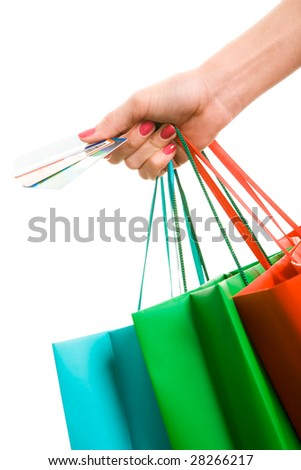 Photo of hand holding shopping bags and three credit cards - stock photo