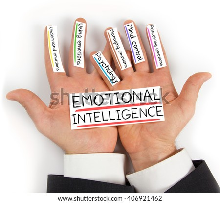 Photo of hands holding EMOTIONAL INTELLIGENCE paper cards with concept words - stock photo