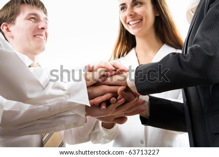 Photo of hands on top of each other - stock photo