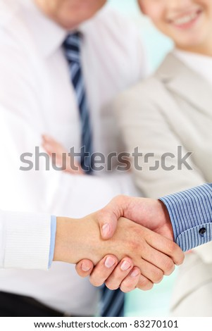 Photo of handshake of business partners after signing contract - stock photo