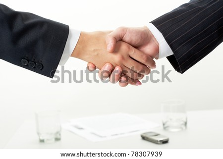 Photo of handshake of business partners after signing new contract