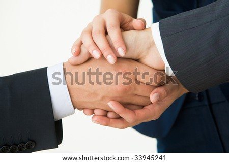 Photo of handshake of business partners after striking deal on white background - stock photo