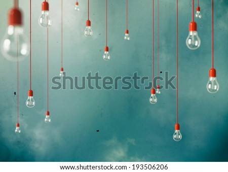 Photo of Hanging light bulbs with depth of field. Modern art - stock photo