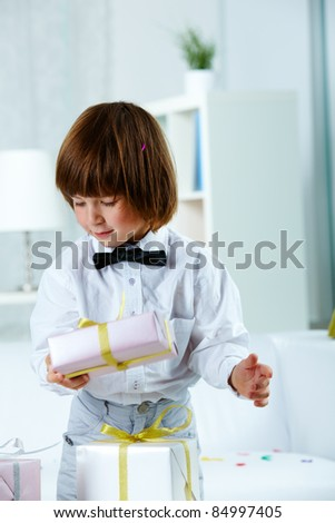 Photo of happy boy with gifts having birthday - stock photo