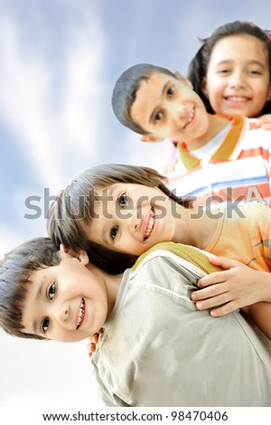 Photo of happy boys with handsome lads in front smiling at camera - stock photo