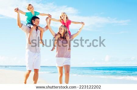 Photo of Happy Family Having Fun on the Beach. Summer Lifestyle. - stock photo