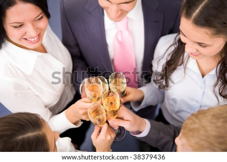 Photo of happy friends making toast during party - stock photo