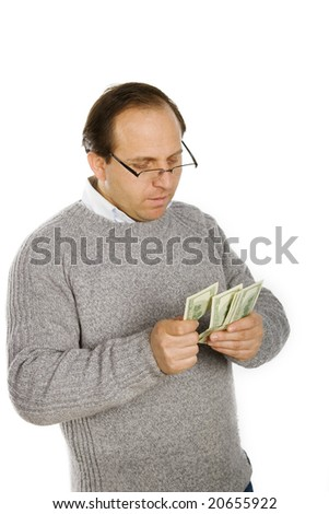 Photo of happy man holding packs of dollars in hands - stock photo