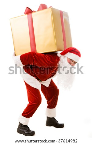 Photo of happy Santa Claus carrying big giftbox on his back - stock photo