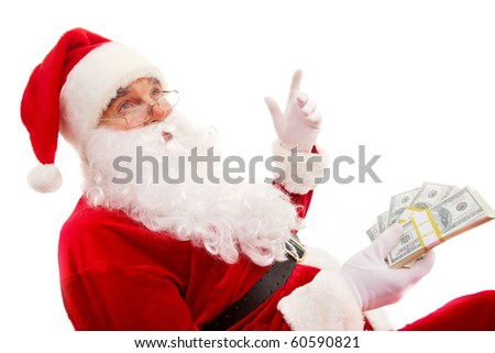Photo of happy Santa Claus with dollar bills gesturing with raised forefinger - stock photo
