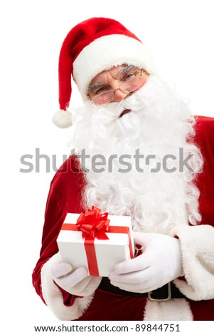 Photo of happy Santa Claus with small decorated box