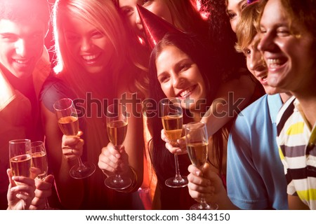 Photo of happy student with beverages during birthday - stock photo