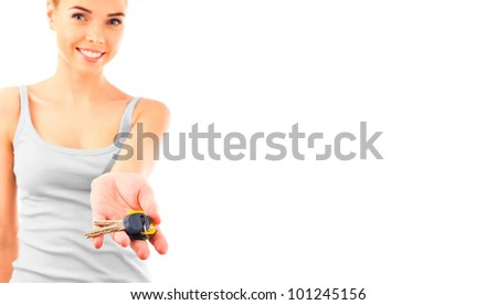 Photo of happy woman construction engineer holding new key and looking at camera. - stock photo
