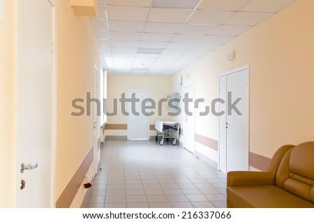 Photo of hospital corridor interior without sicks - stock photo