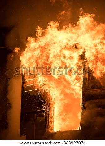 Photo of Huge Flame Distracting House on Fire. Fire Safety Concept - stock photo