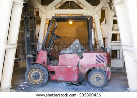 Photo of industrial old desolate lift truck