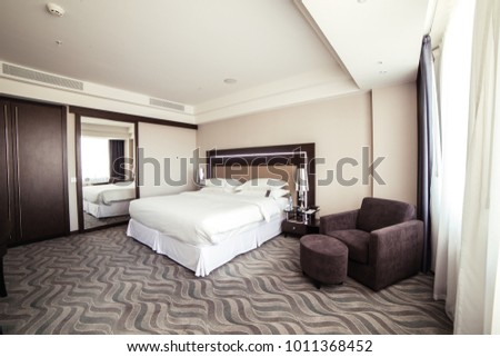 photo of interior design of luxury hotel bedroom