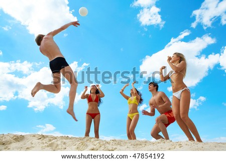 Photo of joyful people holding by hands together and jumping in the lake - stock photo