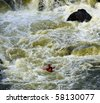 Photo of kayaker in the rapids of the Potomac river - stock photo