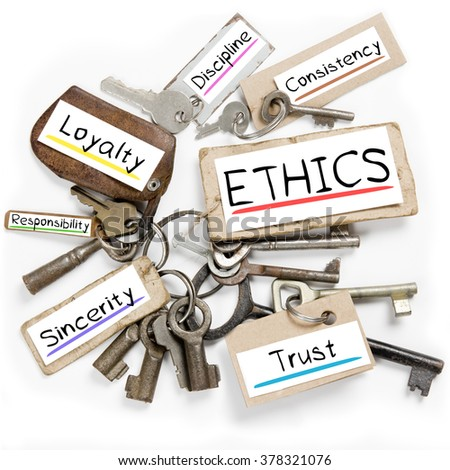 Photo of key bunch and paper tags with ETHICS conceptual words - stock photo