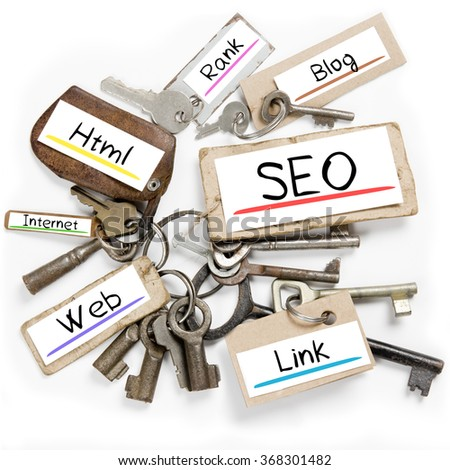 Photo of key bunch and paper tags with SEO conceptual words - stock photo