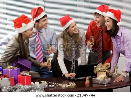 Photo of laughing co-workers interacting during corporate party in office - stock photo