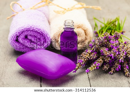Photo of lavender soap and oil over wooden table - stock photo
