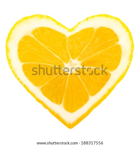 Photo of lemon slice in a heart shape - stock photo